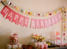 happy birthday sign above the candy table