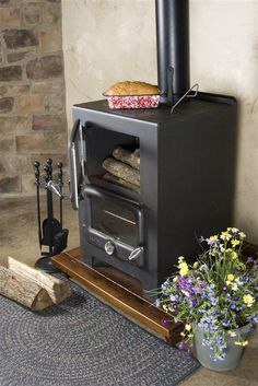 Baker's Oven Wood Heat/Cook Stove. Heats 700 - 900 square feet, is less than 2' square, and you can cook and bake on it to boot.