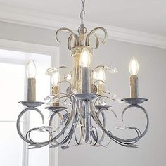 Complete with a distressed grey painted finish this elaborate Annecy ceiling fitting features elegant scrolling arms with five candle holder style fixtures, sus. Flush Lighting, Shop Lighting, Pendant Lighting, Chandelier, Light Bulb Types, Grey Paint, Light Fittings, Candelabra, Home Furnishings