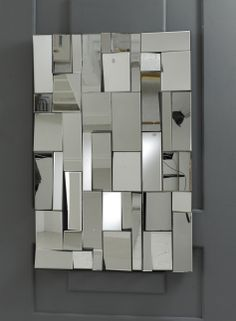 The Pave is a very striking multifacet mirror: it is made up of many rectangular clear glass mirror pieces of different sizes, all set at slightly different angles to give a multi facet effect. This gives a range of fascinating visual effects and provides light and space to any room it is hung in. Size: 120cm x 80cm http://www.totalmirrors.com/multi-facet-mirrors/185-pave-multi-facet-mirror-120x80cm-5055157621053.html