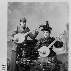 Athens, 1895-1900. Two young women at the University of Georgia pose for a photograph. Note that each is holding a banjo.