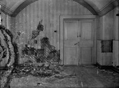 The basement of the Ipatiev house where the Romanov family was murdered, the wall has been torn apart in search of bullets and other evidence by investigators following the shooting, Yekaterinburg, 1918-19. Cr.zolotoivek