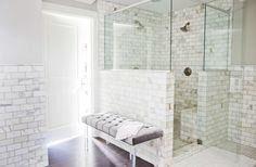dark wood floors, Calcutta Gold marble tile, Benjamin Moore Revere Pewter paint, velvet + lucite bench