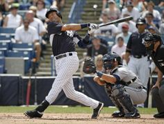 New York Yankees Derek Jeter strikes out in the first inning of a spring exhibition baseball game against the Detroit Tigers in Tampa, Fla., Wednesday, March 12, 2014. (AP Photo/Kathy Willens)