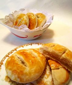 Chinese wife cakes (homemade) - glazed flaky wheat pastry around a sticky sweet rice flour and pineapple centre.-So... @Ellie Holcomb I found these and thought of you... went to look at the recipe and well... its in chinese.