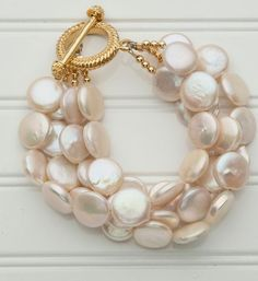 Completely classy this white cultured bracelet with a gold clasp. Every  woman should added to every women s jewelry collection f09eb7e6eddf