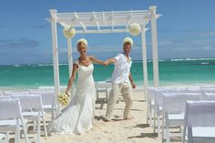 """The pomander floral arrangements give the """"Pure Paradise"""" package a chic romantic touch. Choose the color that best suites your story Karen Bussen Simple Stunning Wedding Packages designed exclusively for Weddings by Palladium"""