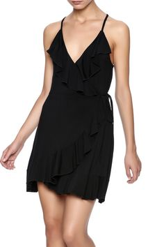 Black wrap dress with ruffled trimming v-neckline and a racer back.  Ruffle Wrap Dress by 143 Story. Clothing - Dresses - LBD Clothing - Dresses - Wrap Dress California