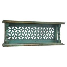 """Showcasing an openwork design and a weathered teal finish, this eye-catching wood wall shelf is a lovely addition to your living room or den.  Product: Wall shelfConstruction Material: WoodColor: Weathered tealDimensions: 10"""" H x 27.5"""" W x 5.5"""" D$80.95"""