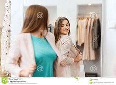 Happy Woman Posing At Mirror In Clothing Store Stock Photo - Image ...
