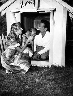 Humphrey Bogart and Lauren Bacall with their pet boxer, Harvey, at their Benedict Canyon home, CA, 1948.