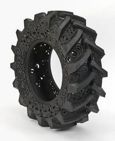 Recycle that old tire w/ decorative art.