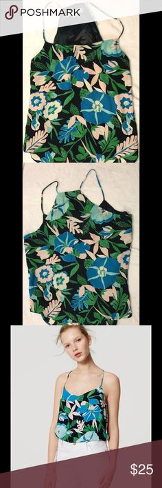 LOFT Jungle Floral Strappy Cami Loft Jungle Floral Strappy Cami comes in a size medium petite.  NWOT. Never worn. Finished with an effortless shirttail hem. V-neck. Spaghetti straps. Slight racerback. Shirttail hem. Lined.  100%Polyester Imported Made in Bangladesh.  All products are  ✅Steamed  ✅Packaged Nicely ✅Next Day Same Day Shipping  ✅Offers Accepted ❌ No Holds  Measurements available upon request. LOFT Tops Camisoles