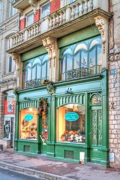Vintage Shop Exteriors & Store Fronts  •~• bright green store front with apartment above