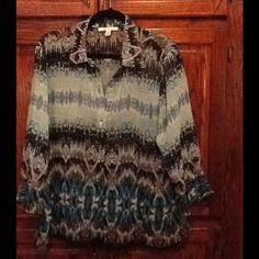 Blouse, Top, XL Beautiful blouse. Multi colored. Has vibrant blues, black and a hint of brown. Bought but could not wear. I ad removed the tags and did not return. The blouse also features a flounce sleeve.  The blouse is sheer and would require a tank under it.  The colors are vibrant. Pictures don't do it justice. JM Collections Tops Blouses