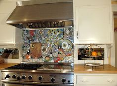 Makes me want to go cook in that kitchen just to look at the backsplash as much as possible!