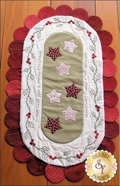"""Create this darling 14"""" x 25"""" Christmas table runner featuring hand embroidery, stars, and a darling scalloped edge! Kit includes everything for only $49.50!"""