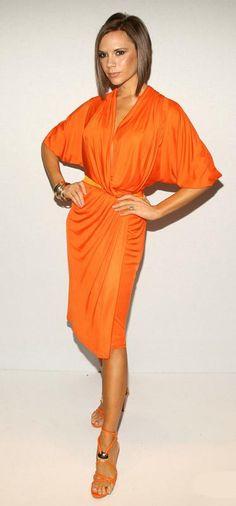 Victoria Beckham wearing Versace Sandals & Donna Karan Dress