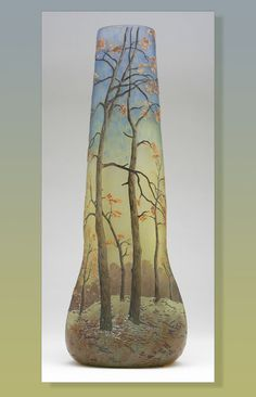 A Legras enameled cameo art glass landscape vase, First quarter 20th century, signed ''Legras'', the circular rim above a spreading pinched body ending in a tripartite base, decorated with a blossoming wooded landscape.
