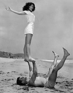 1946. Ava Gardner and Burt Lancaster. Beach acro-yoga.