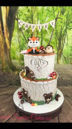 Woodlands theme baby shower cake. Such a cute theme. Our yummy red velvet and funfetti cake with our buttercream filling and topped with our homemade marshmallow fondant.  All animals and cake topper made by me. #sweetsuprisecakes #woodlands #babyshower #fox #squirel #bear #deer #hedgehog #sweet #cake #instagood #yummy #delicious #homemade #fresh #instapic #desert #buttercream #marshmallow #cakestagram #cakesofinstagram #amazingcakes  #cakeinspiration #smallbusiness #cakedecorator #tampa