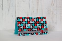 Fabric Checkbook Cover- Black, Blue, & Red Geometric for $12.99. Although using your checkbook is most likely not your favorite activity, now you can look fashionable doing so! With this stylish cover you can spend your money in style! Great as an accessory for yourself or gifts for family and friends!