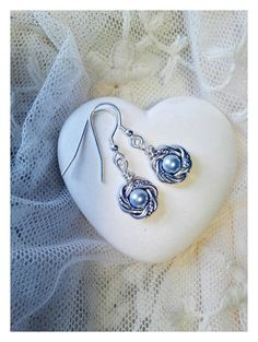 Check out this item in my Etsy shop https://www.etsy.com/listing/234084097/silver-and-baby-blue-pearl-earrings