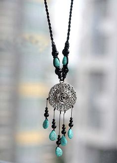 necklace necklace necklace Tibetan Silver openwork sweater chain    Tibetan Silver openwork sweater chain  Material: silver, turquoise, coral, mercerized cotton  Specifications: Tibetan Silver Pendant diameter of about5cm, a total length of about 43cm