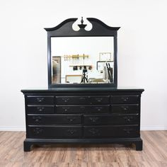 This chippendale dresser is featured in a solid wood with a black paint finish. This long dresser is in great condition with 10 drawers in varying sizes, with a carved lifted base and a carved bonnet pediment mirror. Masculine and elegant storage piece! #chippendale #dressers #longdresser #sandiegovintage #vintagefurniture