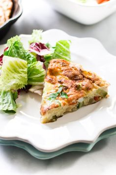 This easy and quick meatless Zucchini Red Bell Pepper Frittata combines eggs with zucchini, red bell pepper and onion to make a delicious dish for lunch.