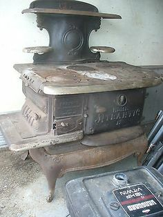 "old Antique cast iron oven /stove ""old Atlantic"" Antique Cast Iron Stove, Antique Stove, Old Stove, Stove Oven, Old West Decor, Antique Kitchen Stoves, Stove Installation, Wood Stove Cooking, Vintage Stoves"