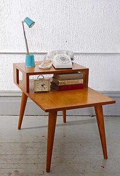 Vintage telephone table used as coffee table.