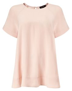 Blush, perfectly draping fabric with a proper sleeve, I can't wait to wear with my leather skirt or vinyl coated jeans