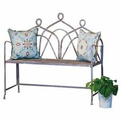 "Bring a lovely touch to your patio seating group or accent your garden path with this rustic metal bench, showcasing a bistro-inspired design and scrolling back.  Product: BenchConstruction Material: MetalColor: Powder greyDimensions: 38.53"" H x 42.13"" W x 17.32"" D Note: Pillows not included"