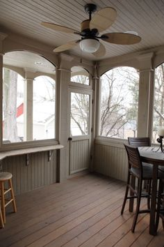 Covered porch outside the screened-in porch. How cool is that?! Again, love the arches. I don't think I like the half wall -- looks nice but would cut down on circulation.