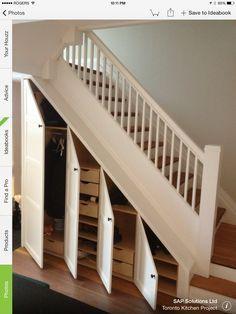 Coat closet under stairs