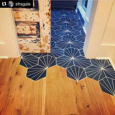 Love this installation of our Nola Blue cement tile. So cool how the tile gradually transitions into the wood floor. Hardwood Floor Colors, Wood Tile Floors, Wooden Flooring, Cement Tiles, Living Room Flooring, Kitchen Flooring, Tile To Wood Transition, Blue Kitchen Tiles, Geometric Tiles