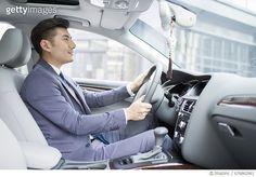 Confident businessman driving car