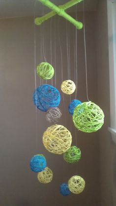 Could be a great backdrop idea! All you need is Starch and balloons and String/yarn! Blow Balloon up cover with string /yarn spray really good with starch, let dry. Pop the balloon and remove! We did Easter eggs for a craft!