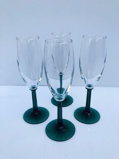 Excited to share this item from my #etsy shop: Vintage, Champagne Flutes, Clear Cups and Paneled Green Stems, Pristine Condition, Saint Patricks Day, Christmas, Garden Party, Barware #clear #wedding #christmas #green #glass #champagneglass #vintageflutes #greenstemflutes #champagneflutes Saint Patricks, St Patricks Day, Vintage Dress Patterns, Vintage Colors, Vintage Champagne, Champagne Glasses, Chip And Dip Bowl, Stems, Christmas Garden