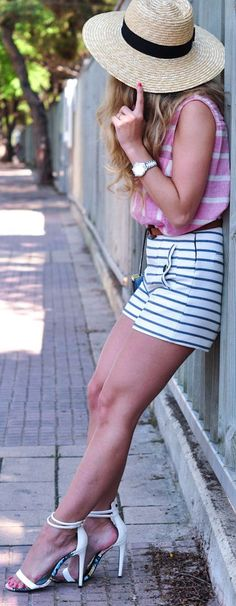 Summertime legs in shorts and ankle strap high heels