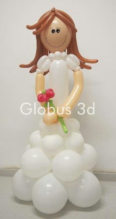 Muñeca de Primera comunión hecha con globos   -   First Communion doll made of balloons