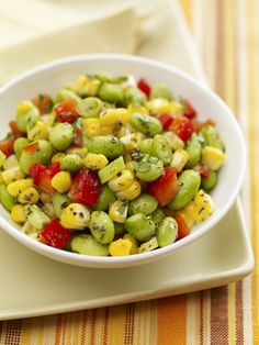 Edamame, fresh summer corn and red bell peppers packing protein and fiber for a lighter summer side.