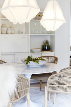 Neutral layered and Beachy dining room // tulip table woven touches