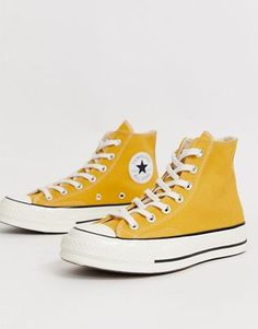 Buy Converse Chuck Hi Sunflower Yellow trainers at ASOS. Get the latest trends with ASOS now. Converse All Star, Converse Outfits, Converse Haute, Converse Chuck Taylor, Converse 70s, Yellow Converse, Converse Sneakers, High Top Converse, Jean Outfits
