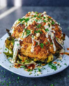 Whole-Roasted Spiced Cauliflower. This Whole-Roasted Spiced Cauliflower is an absolute showstopper but is so simple to prepare! Vegetarian Recipes, Cooking Recipes, Healthy Recipes, Weekly Recipes, Vegan Meals, Roasted Cauliflower Head, Cauliflower Pizza, Coliflower Recipes, Tahini Recipe