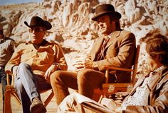 Clint Eastwood sitting with director John Sturges at the set of the western movie Joe Kidd (1972).