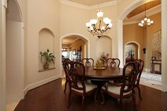 The formal dining room boasts hard wood floors, decorative lighting and a built-in serving bar and butler's pantry Brazilian Cherry Hardwood Flooring, Decorative Lighting, Hard Wood, Full Bath, Light Decorations, Home Values, Pantry, Hardwood Floors, Dining Room