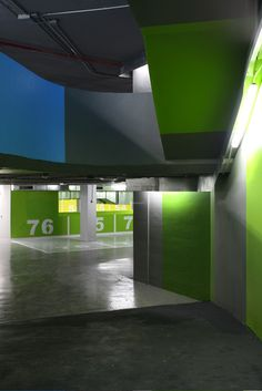 Teresa Sapey Estudio de Arquitectura took a bright approach to this garage as they use bold colors a way to find your car! No more getting lost, if you can't remember you parked in the green zone, there is something majorly wrong