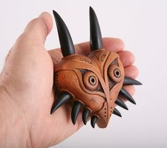 Stylized one of a kind wooden Majora's mask from Zelda, skull kid and Nintendo. Fine woodworking stylized wooden mask for Zelda cosplay.